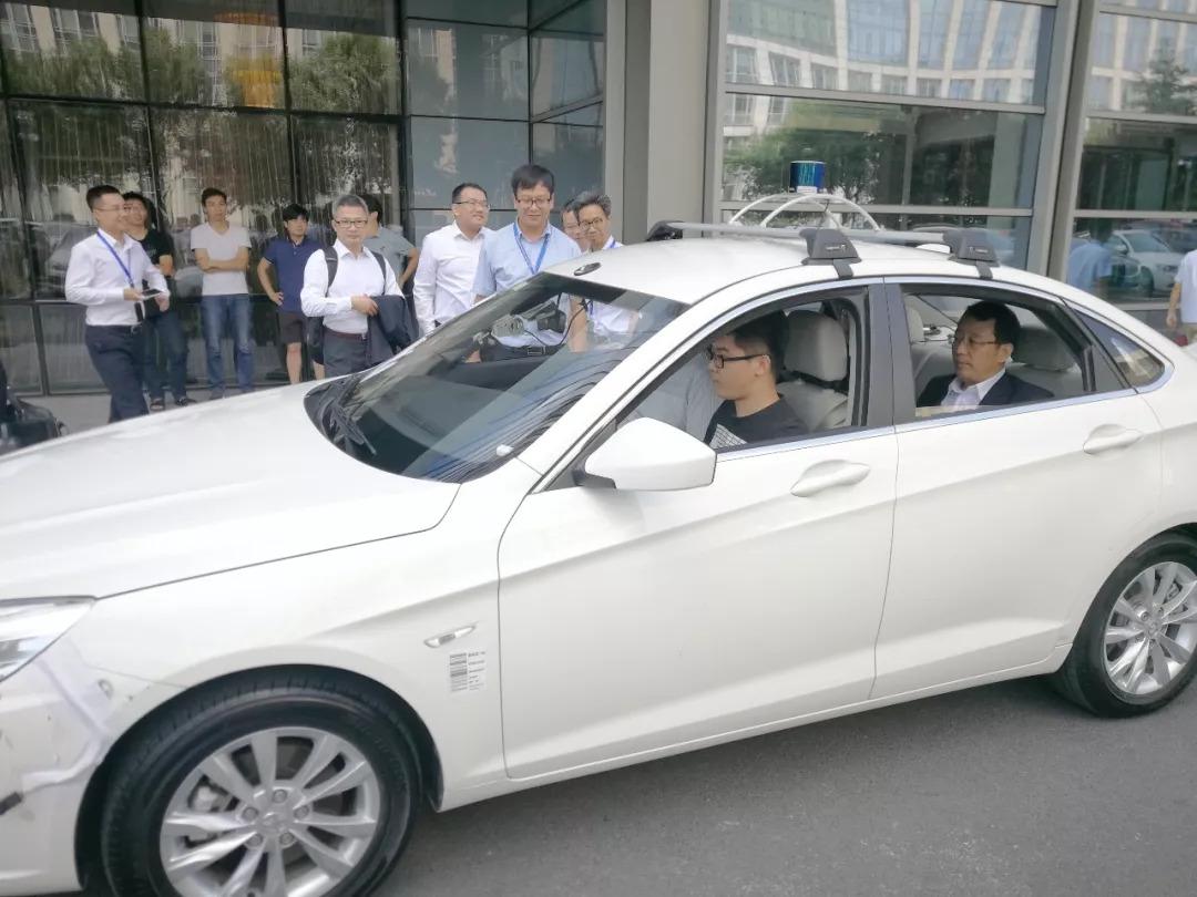 热烈欢迎广汽集团总经理冯兴亚一行来访